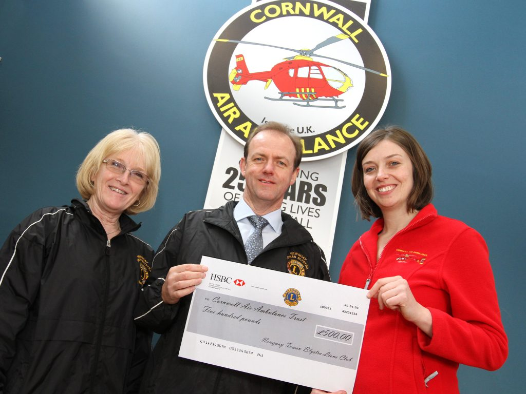 Lions Barbara and Andy Hannan present a cheque to Susie Smith from Cornwall Air Ambulance
