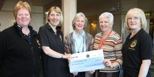 Lions Jill Bunt, and Hillary Smith and Barbara Hannan present a cheque to Cornwall Hospice Care